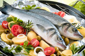 Sea-bass with the vegetables on a grill — Stock Photo