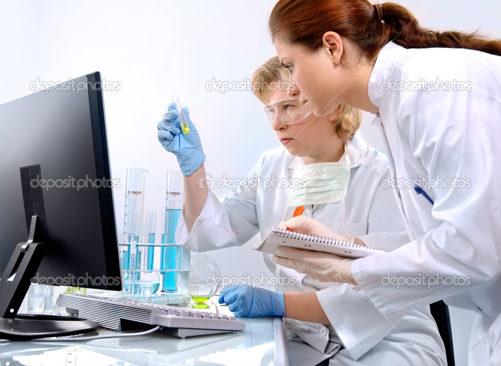 Group of scientists working at the laboratory — Foto de Stock   #6857663