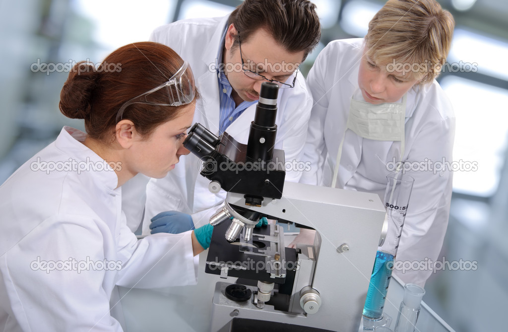 Group of scientists working at the laboratory — Stock Photo #6857816