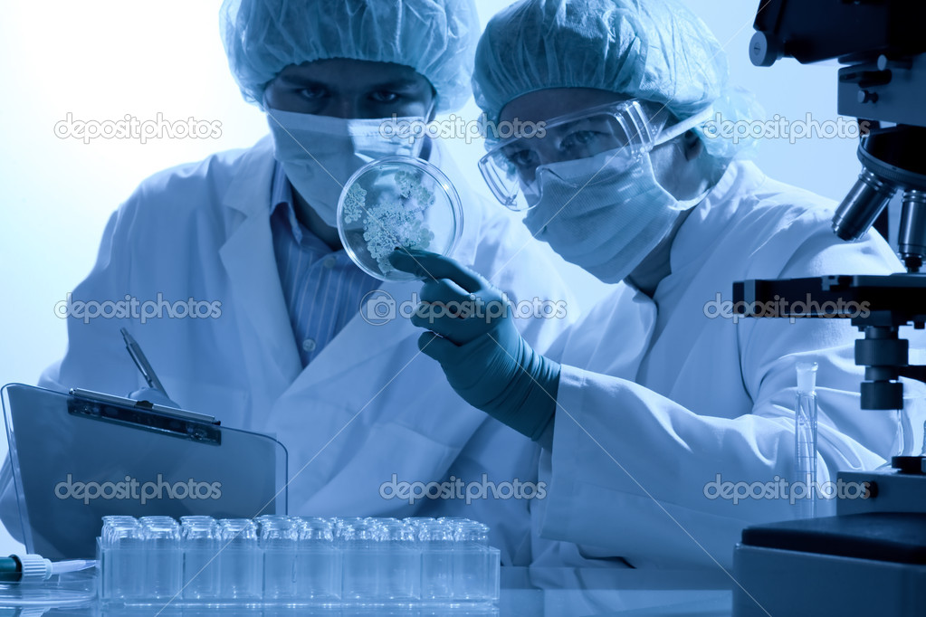 Scientists working at the laboratory  — Foto de Stock   #6858597