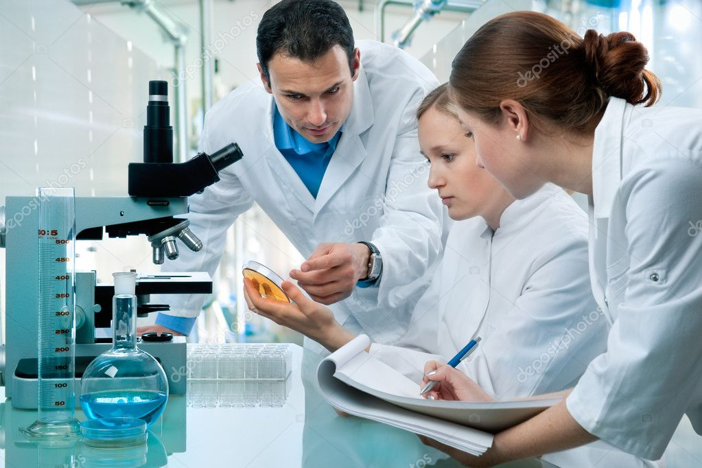 Group of scientists working at the laboratory  — Stock Photo #6859235