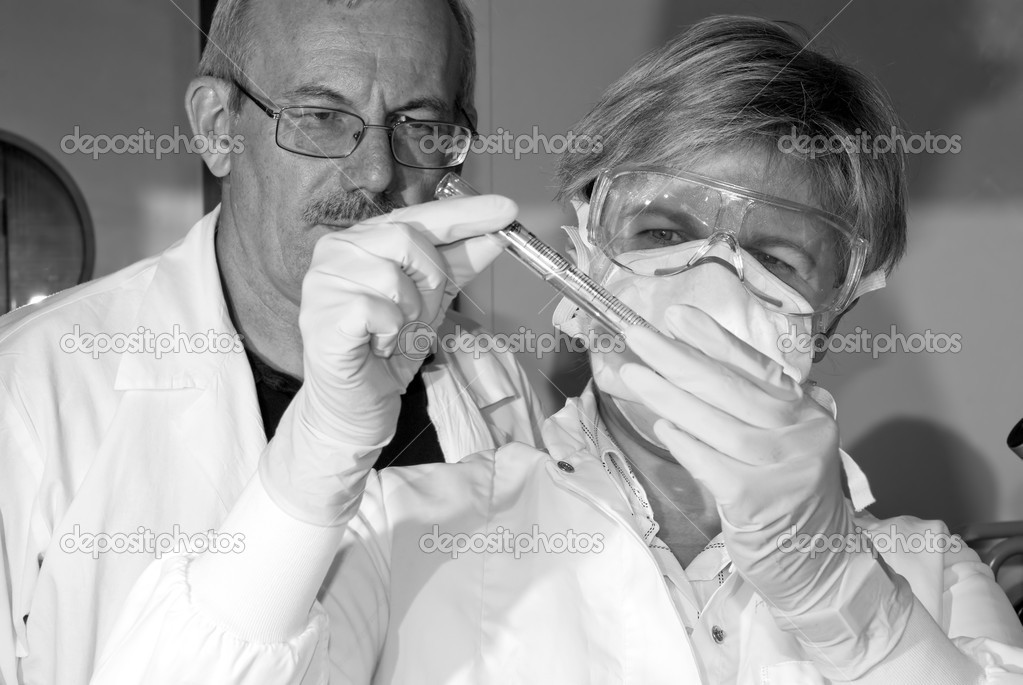 Two science technicians survey the results of their experiments   Stock Photo #6859330