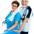 Senior couple in gym - Stock Photo
