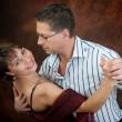 Attractive couple dancing — Stock Photo