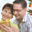 Portrait of a happy couple with gift — Stock Photo