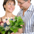 Happy couple with a bunch of flowers — Stock Photo