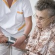 Measuring blood pressure — Stock Photo