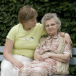 Elderly woman with her daughter - Stock Photo