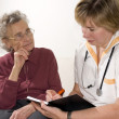An elderly women by a doctor — Stock Photo