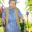 Senior woman with a walker — Stock Photo