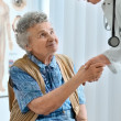 An elderly women by a doctor — Stock Photo #6865052