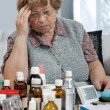Senior woman with her medicine bottles - Stockfoto