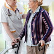 Health care worker and senior patient - Stock Photo