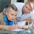 Assisting a senior woman by nurse at home. — Stock Photo #6867297