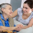 Senior woman with her home caregiver — Foto de Stock   #6867479