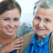 Stock Photo: Senior woman with her home caregiver