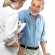 Doctor attending senior man — Stock Photo #6868202