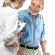 Doctor attending senior man — Stockfoto