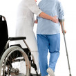 Nurse helps a senior woman on crutches — Stock Photo #6868273