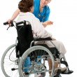 Stock Photo: Nurse with a senior patient in wheelchair