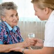 Senior woman with her home caregiver - Foto Stock