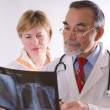 Two doctors looking at an xray — Stock Photo