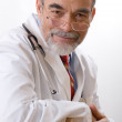 Caring doctor smiling — Stock Photo #6868808