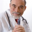 Caring doctor smiling — Stock Photo #6868809