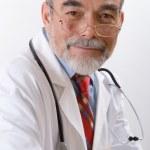 Closeup portrait of a happy senior doctor — Stock Photo