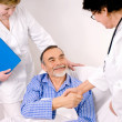 Doctor talking to patient in hospital — Stock Photo #6868909