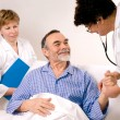 Royalty-Free Stock Photo: Doctor talking to patient in hospital