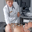 Doctor performing an EKG test — Stock Photo #6868982