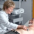 Doctor performing an EKG test — Stock Photo #6868986