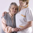 Healthcare worker and senior — Stock Photo