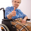 An elderly woman in wheelchair — Stock Photo
