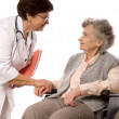 Stock Photo: Health care worker helps elderly woman