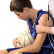Stock Photo: Doctor giving first aid to a young sportsman