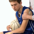 Doctor giving first aid to a young sportsman — Stock Photo