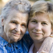 Stock Photo: Elderly womwith her daughter