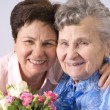 Mother receives a bunch of flower — Stock Photo #6869363