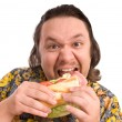 Man eats a sandwich — Stock Photo #6869650