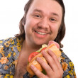 Man eats a sandwich - Stock Photo