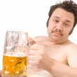 Overweight man with a beer glass — Stock Photo #6869696