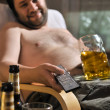 Overweight man with a beer glass — Stock Photo