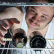 Fat man gets beer from the fridge — Stock Photo #6869773