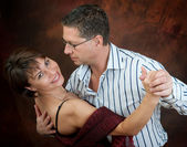 Attractive couple dancing — Stok fotoğraf