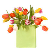 Bouquet of tulips in shopping bag — Stock Photo