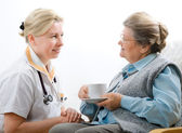 Healthcare worker and senior woman — Stock Photo