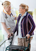 Health care worker and senior patient — Stock Photo