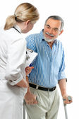 Doctor attending senior man — Stock Photo